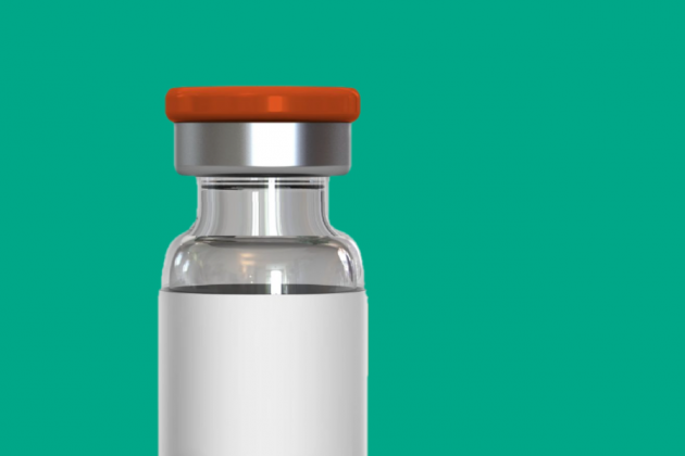A vaccine bottle on a teal background.