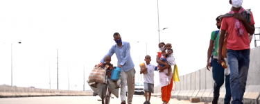 An Indian family walking with masks on. Image: From BBC News Video https://www.bbc.com/news/av/world-asia-52776442