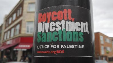 'Boycott, Divestment, Sanctions' sticker on a lamp post. Credit: Turbulent London