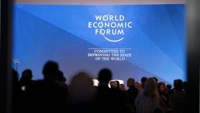 "A screen at DAVOS reads: ""World Economic Forum – Committed to improving the state of the world"". Photo: U.S. Embassy Bern/ Eric Bridiers"