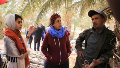 Activists from Algeria and Morocco talking with one of the agricultural workers in the oasis of Jemna in southern Tunisia about their experience since 2011 and the challenges they are still facing. This was part of an international solidarity caravan to southern Tunisia supported by War on Want in the spring of 2017. Photo Credit: Nadir Bouhmouch
